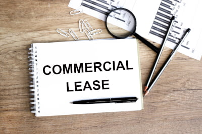 Image of a notepad with the words commercial lease signifying commercial leasing