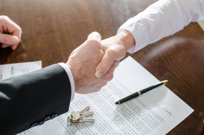 A Handshake signifying a commercial sale deal