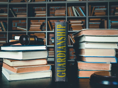 Photo of a law library with a book about Guardianships
