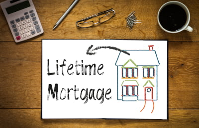 Image of a notepad saying Lifetime Mortgage indicating Equity Release