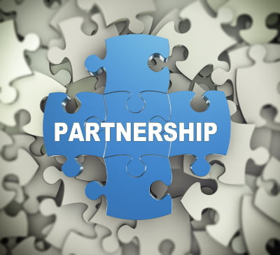 Jigsaw with the word Partnership printed on it signifying partnership agreements