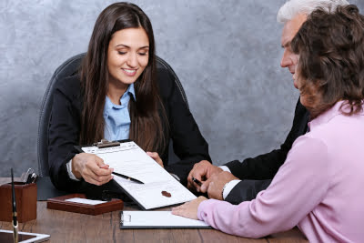 Couple signing a Power of Attorney